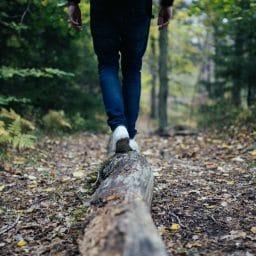 Hiker balancing on a log